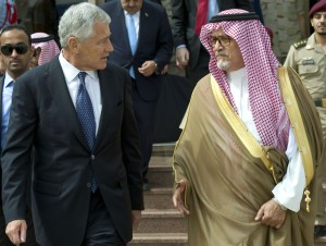 Secretary of Defense Chuck Hagel walks with Saudi Arabia's Prince Fahd bin Abdullah, deputy defense minister
