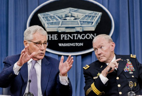 Defense Secretary Chuck Hagel and Chairman of the Join Chiefs of Staff Army General Martin Dempsey briefing reporters at the Pentagon.