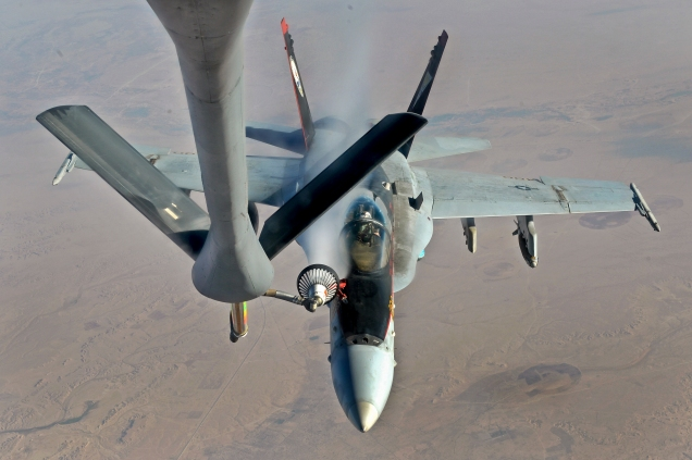 US Navy F/A - 18 Super Hornet refueling midair after conducting airstrikes against ISIS targets in Iraq (Photo: Department of Defense)