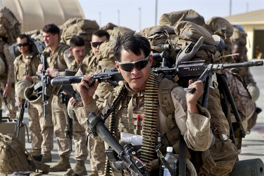 U.S. Marines prepare to board transport plane in Helmand Province, Afghanistan (Photo: Department of Defense)