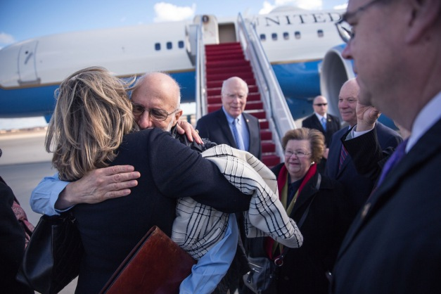 American Alan Gross being embraced after being released by the Cuban government as part of the historic negotiations (White House)