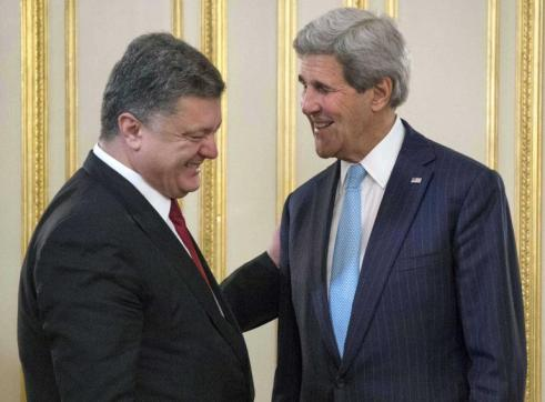 US Secretary of State John Kerry meeting with Ukrainian President Petro Poreshenko on February 5, 2015. He is meeting a few other Ukrainian officials and the leaders of Germany and France to discuss a joint plan of action to deal with continued escalation of the conflict. Reuters/Jim Watson