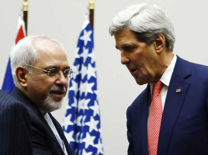 U.S. Secretary of State John Kerry shakes hands with Iranian Foreign Minister Mohammad Javad Zarif